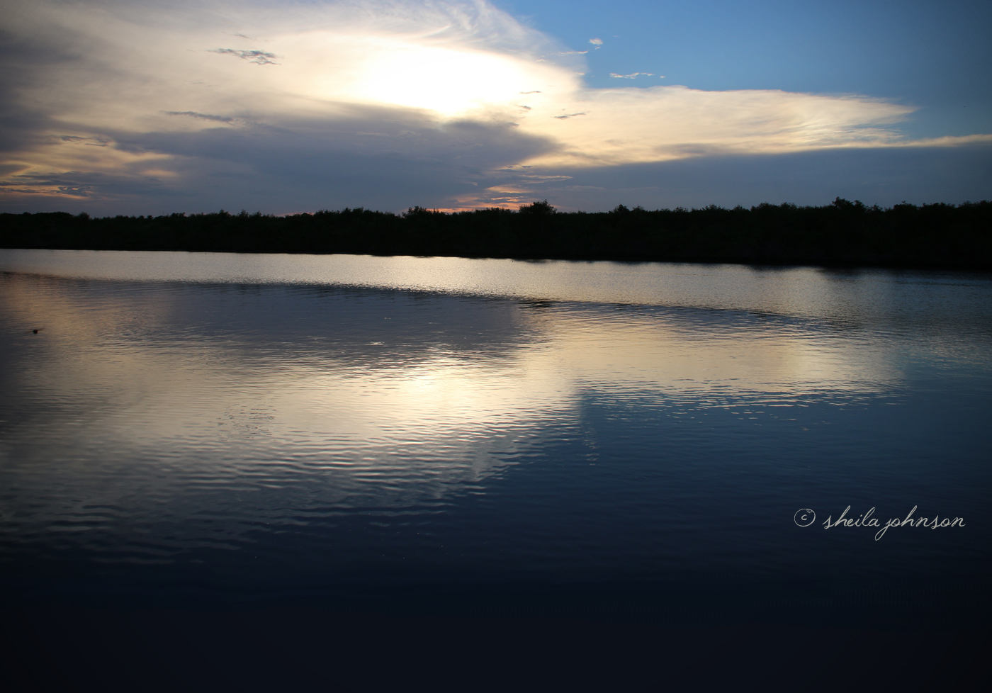 We *love* How The Reflection Of The Cloud Makes A Heart In The Water In This Image Taken Overlooking The St. Lucie River At Kiplinger Preserve, Stuart, Martin County, Florida.
