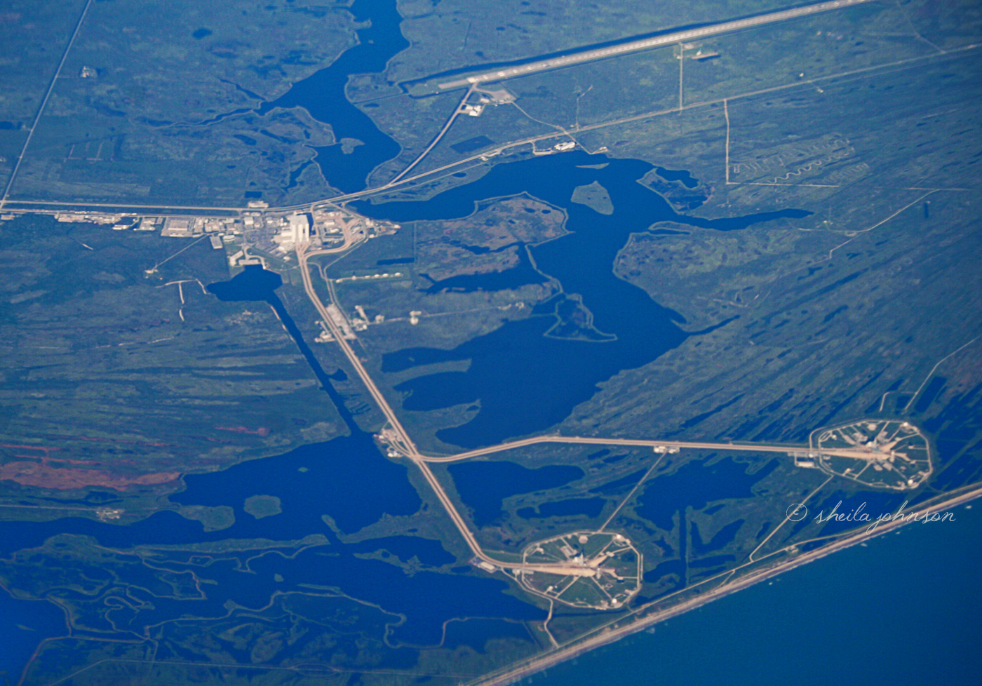 Sometimes You're In The Right Place At Just The Right Second. Such Was The Case On A Commercial Southwest Flight From Baltimore To Palm Beach. We Flew Over Kennedy Space Center, And I Happened To Be On The Right Side Of The Plane. The Two Circles In Front Are The Launch Pads Used In The Space Shuttle Program.