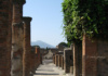 A Street In Pompeii, Italy, With Mount Vesuvius In The Background. The Eruption Of Mount Vesuvius In 79 A.d. Killed Everyone And Everything In Its Path.